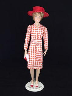 "This Franklin Mint Diana doll is wearing a replica of the ""Rising Sun"" dress by the Emanuels & hat by Frederick Fox that Diana wore on an official trip to Japan May 9, 1986."