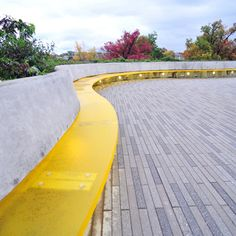 Cornell University Bench.  A prominent feature of this project is a sinuous yellow bench, which responds to an important goal for creating positive social spaces for students. The bench, in 2-inch 3form Chroma Marigold*2 creates a floating plane, illuminated from below, that is ever-changing in profile and depth, giving students a variety of sitting and/or lounging alternatives. The colour yellow was chosen to evoke the sense of sunlight, something rare in the Ithaca climate.