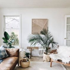 51+ Boho Chic living room ideas - Modern bohemian living room with plants