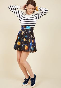 Lift your spirits while scoring major style points in this circle skirt! A print of brightly colored celestial bodies delight on this cotton garment, which brings a touch of whimsy to your everyday look. Worn with your winning smile, this black, blue, and orange skirt will make your day cheery from start to finish.