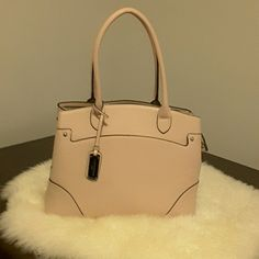 Purse Large, NWOT,  never used, paper still inside, Appears to be saffiano  leather but I thought all London Fog bags were man- made so I do not know the material. Unfortunately,  I removed the tags. Double rolled stiff straps. Zipped divider section in middle of purse.  Light pink. If interested, make offer. London Fog Bags Totes