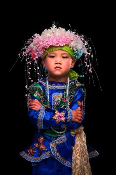 Kenneth Bamberg's Flowers is a series of portraits of young Shan tribe boys undergoing a male right of passage in northern Thailand. The ritual is called Poi Sang Long, and the boys are dressed up in bright colours and adorned with make-up to mimic the young Prince Siddhartha before he became Buddha.