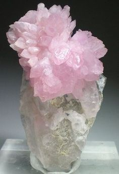 Rose Quartz - This is a stone of the heart. A crystal of un-conditional love. It dissolves emotional wounds, fears, & resentments. It reawakens the heart to its own innate love allowing one to truly give and receive love. Attracts new love, romance, intimacy, & closer bonds with family and friends.