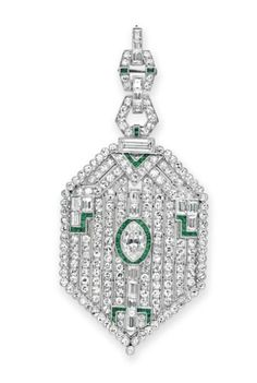 AN ART DECO DIAMOND AND EMERALD PENDANT BROOCH   Designed as a shield-shaped single and baguette-cut diamond plaque, centering upon a marquise-cut diamond with calibré-cut emerald detail, to the detachable double link pendant hoop of similar design, mounted in platinum, circa 1925