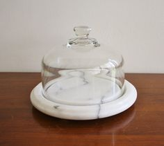 Marble and glass cheese dome...I have one just like this I use to keep butter in. The marble keeps it at room temp so it's spreadable and easy to toss into sauces!