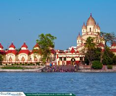 Dakshineswar Kali Temple in Kolkata, India  |  Dakshineswar Kali Temple is a Hindu temple located in Dakshineswar near Kolkata. The temple compound, apart from the nine-spired main temple, contains a large courtyard surrounding the temple, with rooms along the boundary walls.  |    Book Now: https://www.cheapflightstoindiauk.co.uk/destination-guide/kolkata  |  #India #Kolkata #DakshineswarKaliTemple #FlightstoKolkata #CheapFlightstoIndia