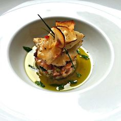 Halibut with octopus risotto, yucca, basil olive infusion, mint