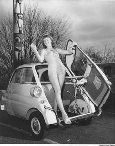 Marilyn Ganes, was photographed leaning out of the front door of a BMW Isetta 300. c. 1958