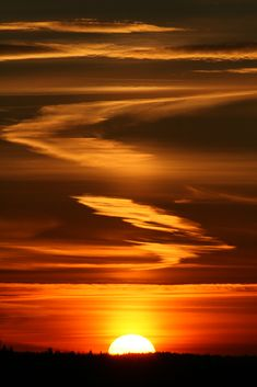 Beautiful cloud formation hi-lighted by the sunset