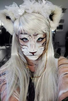 I'd so love to be this tigress! Just lovely.  DIY Halloween Makeup : Halloween Make up Tigress #halloween #makeup Learn how to do the best Halloween makeup yourself.