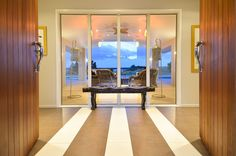 Through the double front door you see across the outdoor living room towards the stunning pool!