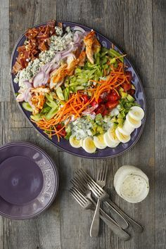Adding buffalo chicken and a light ranch dressing to this cobb salad makes for a scrumptious lunch or dinner.