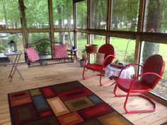 I painted these old chairs red. I loved them so I put them on my porch instead of back out in the yard.