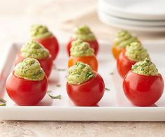 adorable avocado pesto stuffed tomatoes. the perfect hors d'oeuvres