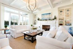 Country Living Room with stone fireplace, Box ceiling, Paint 1, Transom window, Standard height, Fireplace, Hardwood floors