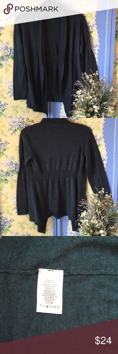 Eddie Bauer Dark Teal Sweater Eddie Bauer sweater hangs open and slightly longer in the front; gathered at waist in back. Good used condition. Nice lighter weight for spring. Make an offer! Remember to bundle for a discount! Eddie Bauer Sweaters Cardigans