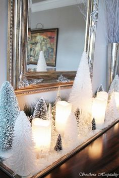 White bristle brush trees, white candles and snow for entry table - beautiful! Could keep all winter!