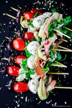Antipasto skewers with prosciutto, mozzarella, and artichoke hearts. An easy  appetizer for your next party!