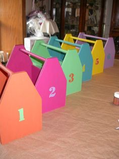 Tool boxes that are on each of my 6 tables filled with supplies for the kids. Goes with our construction theme.