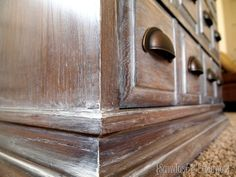 DIY:  How to Get this Restoration Hardware Paint Finish - by brushing a white glaze over a wood finish.  This has to be the easiest redo - ever! - via Sawdust and Embryos