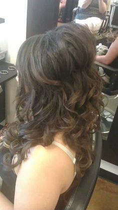 full volume half-up style.  For more info on formal styles check out our website www.salonrouge.com
