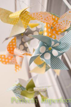 DIY pinwheel mobile - the photo mobile clips we sell are perfect for this! And we just got new Japanese origami paper ...