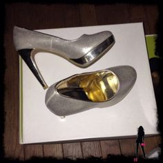 "NWOB Metallic Gold Platform Pumps by Rampage Sz 6 New with out box Rampage brushed gold platform pumps. Heels and platforms have high shine gold finish. Heel height is 4"" and platform is .75"". These shoes are brand new and have never been worn but one of the bottoms (soles) is a little dark probably from being tried on in store. Size 6 Rampage Shoes Heels"