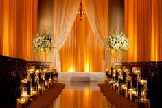 Outstanding #weddingaisle made even more luxurious with accent amber #uplighting! Photo via #trendvee