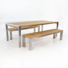 An outdoor dining set made from the best materials, this Stainless Steel and Teak Plank Table comes with two benches.