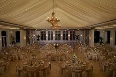 Twinkle lights illuminate the silk draping on the ceiling of The Patrick C. Haley Mansion ballroom in Joliet, IL.