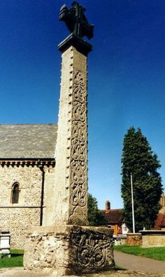 St Nicholas Church, Castle Hedingham. A tapered monument carved on four sides in a true Norman style. It was found in the cellar of a coaching inn in Falcon Square.