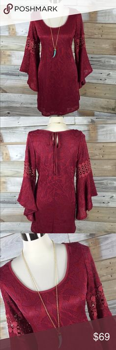 Eye-Catching Bell Sleeved Poshmark Burgundy Dress This dress is so amazing! Gorgeous and so soft, material is a deep burgundy with a burnout floral pattern (see closeup photo)...dress features incredible bell sleeves with cutout crochet panels at elbows. Fully lined with underslip. Keyhole tie-closure at back of neck adds cute detail, and short swing-hem adds retro flair. NWT Va-Va by Joy Han; Size Medium Va Va Voom Dresses