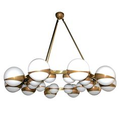 Round Globe Chandelier | From a unique collection of antique and modern chandeliers and pendants at https://www.1stdibs.com/furniture/lighting/chandeliers-pendant-lights/