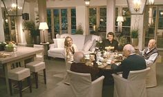 Idea to make small sitting area in kitchen also the free standing columns and doors and lighting - - Cameron Diaz's house in the movie The Holiday