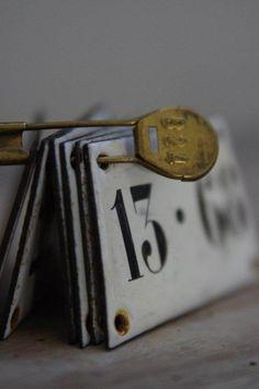 Numbers on rustic metal placards...