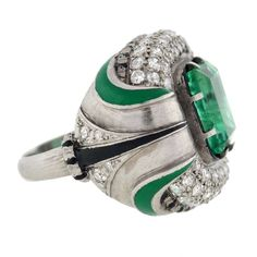 1930s amazing platinum with green and black enamel grooved shoulders featuring center 3ct large emerald cut emerald surrounded by glittery white diamonds, made b mercade