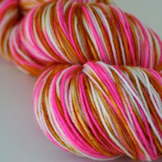 Tequila is part of our new collection of hand dyed sock yarns!    Hand painted in hot pink and gold using professional dyes.    >Yarn Details <    75% Superwash Merino Wool :: 25% Nylon 462 Yards :: 100 Grams    Fingering weight :: 7-8 sts = 1 on # 1-3 needles.    Machine wash:: Tumble dry low    Perfect for a pair of socks, small shawl or baby items