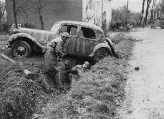 French commandos capture a German soldier - caught hiding in a ditch under a ruined car - during the battle for the liberation of the city of Belfort, France, 1944. [x]