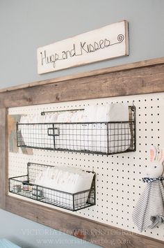 Here's another look at the DIY diaper holder that would work great in a nursery!!!  My clients had this brilliant idea to use a peg board and these metal baskets for a diaper holder. They made this themselves!!! A pretty awesome DIY nursery project!!