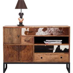 KARE sideboard Rodeo - The inspiration for the designers who created this characterful furniture range was the scent of mountain forests flooded with sunlight and the warm cosiness of a mountain resort. The fronts with their cowhide trim and beautiful carvings give this series its urbane and rugged charm. Each piece is individual and unique. #kare #karedesign #holz #fell #kommode #dresser #chest #drawers #rustikal #wild #zuhause #style #ornamente