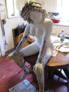Figure Sculpture After During Process of Covering With Paper Mache Clay