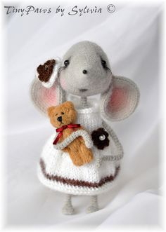 Mouse Sofia project. Crochet pattern by LittleOwlsHut SKILL LEVEL: Intermediate FINISHED SIZE: Approx. 20 cm (8 inches) high. MATERIALS AND TOOLS • Steel Hook 2 mm • Hook 3.5 mm • 2 Knitting needles 5 mm for making skirt. • 4 Knitting needles 4 mm for making top of the dress. • Yarn (mouse) wool or Mohair 40 g (Light Fingering / 3 ply - 500 m per 100 g skein). • Yarn Mohair for a dress 10 g (Lace / 2 ply - 250 m per 25 g skein).