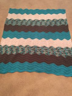 A personal favorite from my Etsy shop https://www.etsy.com/listing/268895288/handmade-crochet-afghan-throw-chevron