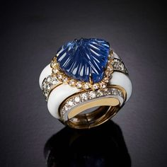 Veschetti Carved Sapphire, Brilliant-Cut Diamonds, White Enamel,18K Gold and Platinum Ring