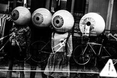 EDITOR'S PIC OF THE DAY Photo: Osamu Jinguji Four Mannequins, bicycles and an exclamation mark (!) reflected in a window across the road. Located in Omotesando, Tokyo. See more here »> http://www.lifeforcemagazine.com/photoessays.htm