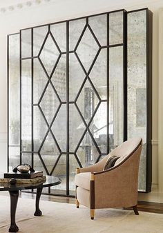 10 Glamorous Art Deco Interiors You Have to See note to self: laser cut panels & glass door for foyer/hall entry separation.
