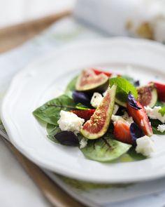 Figs, strawberries, greens, cheese = a delicious summer salad. Good eats via Weekday Carnival #Salad #Recipe