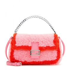 Fendi - Micro Baguette shearling shoulder bag - Inject a little playful sophistication into your evening looks with this 'Micro Baguette' bag from Fendi. Covered in plush pink and red shearling, the compact size is perfect for carrying your essentials. Carry it against a shift dress and ankle boots this season for a sweet finish. seen @ www.mytheresa.com