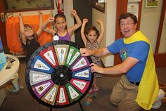 It was quite evident the kids in town definitely take their story times seriously! Afterwards, they let me spin their prize wheel! Who can guess what I won? Buy this Prize Wheel at http://PrizeWheel.com/products/tabletop-prize-wheels/table-clicker-prize-wheel-12-24-slot-adaptab/.