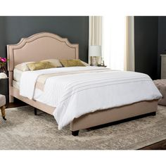 Upholstered from head to toe, this romantic queen bed speaks to modern elegance with refined lines and gracious curves.
